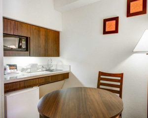 kitchen area with dining table in guest suite